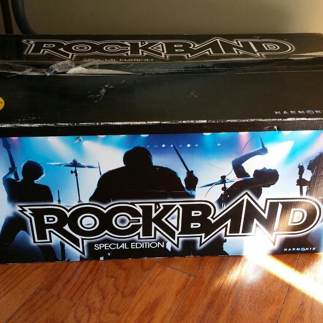 Rock Band for PS2  USB hub  All pieces present in box  Used maybe twice   Meet at Target weekdays after 40
