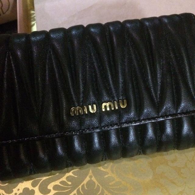 4f83485b8c27 Best Authentic Miu Miu Matelasse Black Leather Wallet for sale in  Henderson