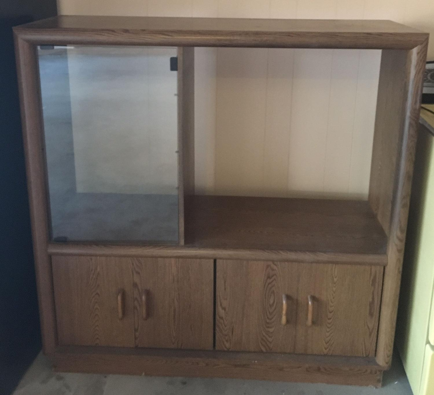 Best entertainment center in great used condition must go for Furniture 77429
