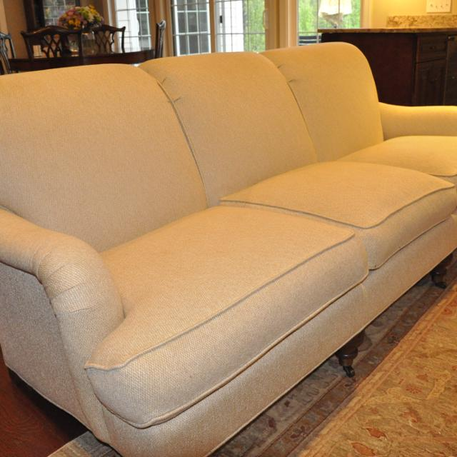 Cream Colored Upholstered Sofa