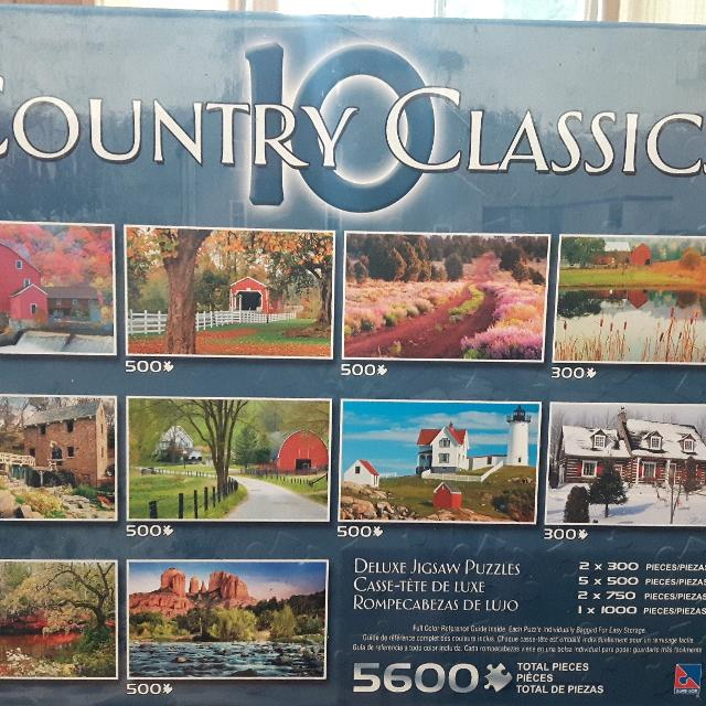 10 country classic deluxe jigsaw puzzles  1 puzzle missing 1 peice